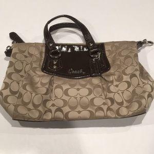 Signature coach design strapless medium handbag